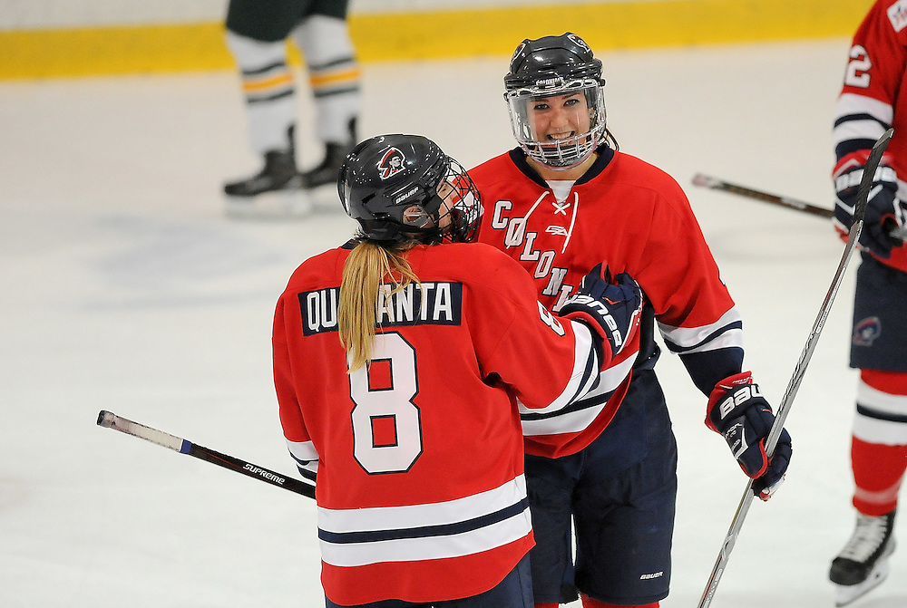 PITTSBURGH, PA - OCTOBER 14:  Kirsten Welsh #4 of the Robert Morris Colonials celebrates her goal with Sarah Quaranta #8 in the second period during the game against the Vermont Catamounts at 84 Lumber Arena on October 14, 2016 in Pittsburgh, Pennsylvania. (Photo by Justin Berl)