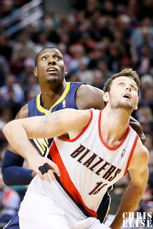 02 December 2013: Indiana Pacers center Ian Mahinmi (28) vies for the rebound with Portland Trail Blazers center Joel Freeland (19) during the Portland Trail Blazers 106-102 victory over the Indiana Pacers at the Moda Center, Portland, Oregon, USA.