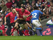 27/03/2004  -  RBS Six Nations Championship 2004 Wales v Italy.Stephen Jones is held back by the tackle from Paul Griffen as he try to break through.   [Mandatory Credit, Peter Spurier/ Intersport Images].
