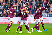 Ryotaro Meshino (#77) of Heart of Midlothian FC is hugged by Sean Clare (#8) of Heart of Midlothian FC after scoring the opening goal during the Ladbrokes Scottish Premiership match between Heart of Midlothian and Rangers FC at Tynecastle Park, Edinburgh, Scotland on 20 October 2019.