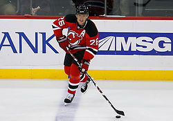 Nov 5, 2008; Newark, NJ, USA; New Jersey Devils left wing Patrik Elias (26) skates with the puck during the second period at the Prudential Center.