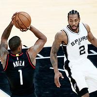 01 May 2017: Houston Rockets forward Trevor Ariza (1) takes a jump shot over San Antonio Spurs forward Kawhi Leonard (2) during the Houston Rockets 126-99 victory over the San Antonio Spurs, in game 1 of the Western Conference Semi Finals, at the AT&T Center, San Antonio, Texas, USA.