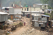 Reconstruction has begun around the Singati Bazaar in Dolakha, Nepal as seen April 13, 2016, where over 100 bodies were buried under the ruble following the April 25, 2015 earthquake and May 12 aftershock. Singati was the major market for residents of 21 Village Development Committees and many survivors of the April 25th earthquake were in the bazaar buying supplies when the aftershock hit causing a huge landslide.<br /> &copy; 2016 Michelle McLoughlin