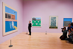 "© Licensed to London News Pictures. 06/02/2017. London, UK. The media photographs a staff member viewing ""A Bigger Splash"" at the preview of the world's most extensive retrospective of the work of David Hockney at the Tate Britain, which will be on display 9 February to 29 May 2017. Photo credit : Stephen Chung/LNP"