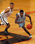 4 FEB. 2010 -- WEBSTER GROVES, Mo. -- Webster Groves Rayshawn Simmons (13, CQ) and Parkway West's Charles Thomas (15) purse a loose ball during the game Thursday, Feb. 4, 2010 between Webster Groves and Parkway West at Webster Groves High School. Photo (c) copyright by Sid Hastings.