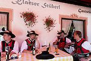 Group of men at beer festival in the village of Klais in Bavaria, Germany