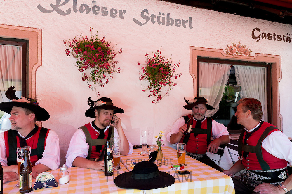 Group of men at beer festival in the village of Klais in Bavaria, Germany