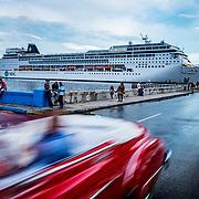 A massive cruise ship comes to port in Havana, Cuba.