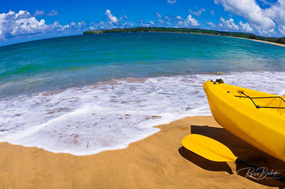 Kayak and paddle on beach on Hanalei Bay, Island of Kauai, Hawaii