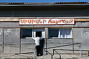 A village man buys bread at the bakery near Stepanakert, Nagorno-Karabakh..Image © Arsineh Houspian/Falcon Photo Agency.