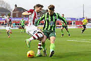 Jake Reeves of AFC Wimbledon forces Exeter wide during the Sky Bet League 2 match between Exeter City and AFC Wimbledon at St James' Park, Exeter, England on 28 December 2015. Photo by Stuart Butcher.