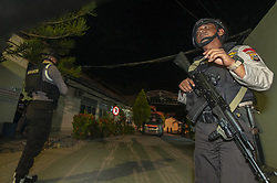 March 22, 2019 - Palu, Central Sulawesi, Indonesia - PALU, INDONESIA - MARCH 22 : An Indonesia Police stand guard in front of the morgue where three members of the Poso East Indonesia Mujahidin (MIT) are buried at the Bahayangkara Police Hospital in Palu, Central Sulawesi, Indonesia, Friday, March 22, 2019. Army forces and police who were members of the Tinombala Task Force shot dead three members of the East Indonesia Mujahidin in Poso in gunfire that took place in Air Teh Hamlet, Marete Village, Sausu District, Parigi Moutong District, Central Sulawesi Province, Thursday (March 21, 2019). Officers also seized weapons, ammunition and bombs from the victims. (Credit Image: © Sijori Images via ZUMA Wire)