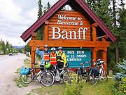 "We reach the wood sign ""Bienvenue / Welcome to Banff"" after completing 187 miles bicycling from Jasper to Banff. Banff National Park, Alberta, Canada. For licensing options, please inquire."