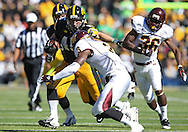 September 22 2012: Iowa Hawkeyes fullback Mark Weisman (45) eyes Central Michigan Chippewas defensive back Taylor Bradley (3) on a run during the first half of the NCAA football game between the Central Michigan Chippewas and the Iowa Hawkeyes at Kinnick Stadium in Iowa City, Iowa on Saturday September 22, 2012. Central Michigan defeated Iowa 32-31.