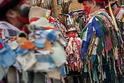 UNITED KINGDOM, Whittlesey: Straw Bear Festival. A young Morris dancer is almost lost amongst the colours of his fellow dancers as they relax during the Straw Bear festival this weekend. The three day festival, which originated in 1882, consists of traditional Molly, Morris, Clog and Sword dancing as well as parading a large straw character known as 'The Bear' through the town. Rick Findler  / Story Picture Agency