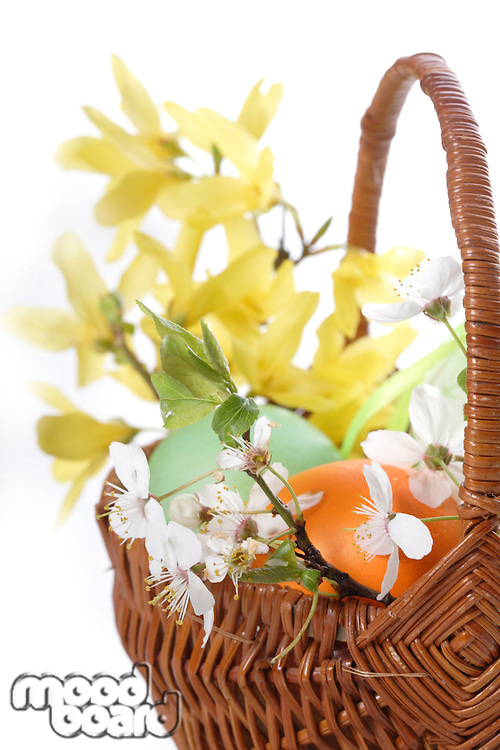 Studio shot of basket with easter eggs