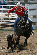 062109-Evergreen, Colo.-tiedownroping-Darnel Johnson during the 2009 Evergreen Rodeo PRCA Tie Down Roping Competition Sunday, June 21, 2009 at The Evergreen Rodeo Grounds..Photo By Matthew Jonas/Evergreen Newspapers/Photo Editor