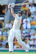 "Mitchell Johnson holds his form after nailing a boundary straight down the ground on Day 1 of the 1st Test in the 2013-14 Ashes Cricket Series between Australia and England at the GABBA (Brisbane, Australia) from Thursday 21st November 2013<br /> <br /> Conditions of Use : NO AGENTS ~ This image is subject to copyright and use conditions stipulated by Cricket Australia.  This image is intended for Editorial use only (news or commentary, print or electronic) - Required Image Credit : ""Steven Hight - AURA Images"""