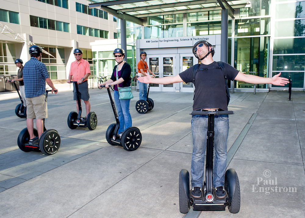 """Portlandbysegway.com guide Jered Hamilton, right, does his no-hands """"Segway Jesus"""" immitation at Portland State's College of Engineering Building 1930 SW Fourth Ave 6:34pm"""