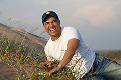 man having a laugh while on a sand dune in East Hampton, NY