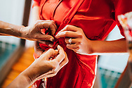 A Chinese bride is helped into a red dress, Ko Samui, Thailand, Southeast Asia