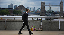 June 5, 2017 - London, London, United Kingdom - Image licensed to i-Images Picture Agency. 05/06/2017. London, United Kingdom. Members of the public laying flowers near the scene of the London Bridge Terror attack.  Picture by Dinendra Haria / i-Images (Credit Image: © Dinendra Haria/i-Images via ZUMA Press)