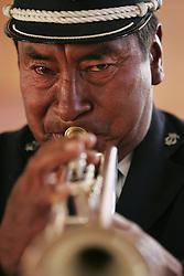 A man plays the trumpet in El Alto, Bolivia.
