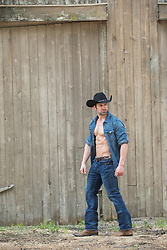 hot cowboy with open shirt showing his muscular body