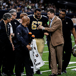 Dec 17, 2017; New Orleans, LA, USA; New Orleans Saints offensive guard Larry Warford (67) is helped off the field by trainers after suffering a concussion during the second quarter against the New York Jets at the Mercedes-Benz Superdome. Mandatory Credit: Derick E. Hingle-USA TODAY Sports