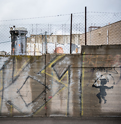 1 March 2020, Bethlehem: A girl skips rope in a drawing on the separation wall that runs through Bethlehem.