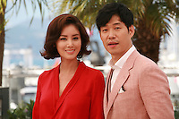 Kim Sun-Ryoung and Yu Jun-Sang at the photo call for the film The Target at the 67th Cannes Film Festival, Friday 23rd May 2014, Cannes, France.