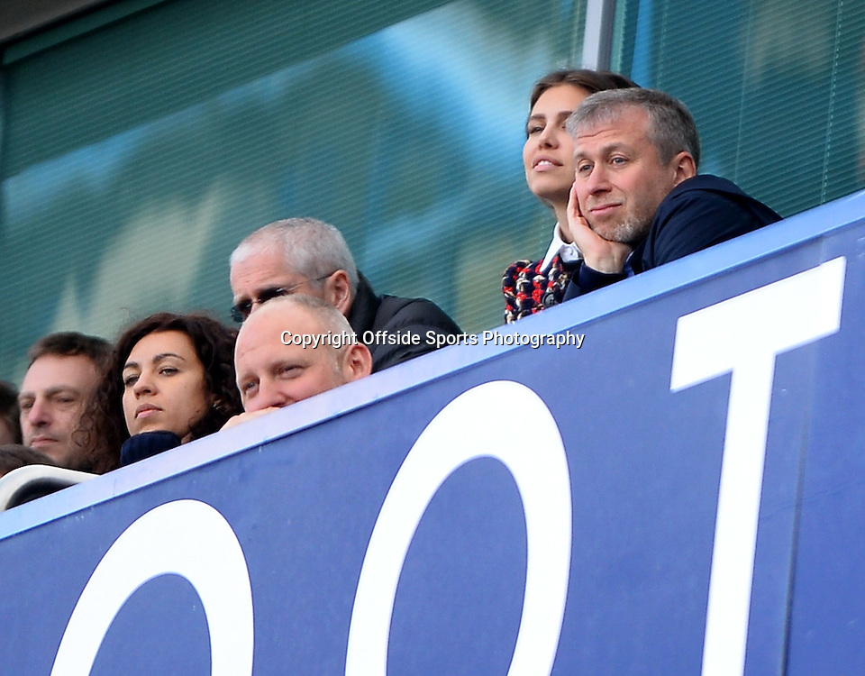 22 March 2014 - Barclays Premier League - Chelsea v Arsenal - Chelsea owner, Roman Abramovich looks on from his private box with partner, Dasha Zhukova - Photo: Marc Atkins / Offside.