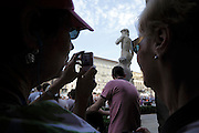 David by Michelangelo in front of Palazzo Vecchio Florence Italy with tourists making a picture
