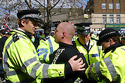 A BNP member being arrested by Police at a BNP Rally outside Finsbury Park Mosque, London.
