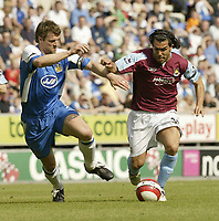 Photo: Aidan Ellis.<br /> Wigan Athletic v West Ham United. The Barclays Premiership. 28/04/2007.<br /> West Ham's Carlos Tevez goes past Wigan's Arjan De Zeeuw