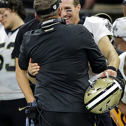 Oct 8, 2018; New Orleans, LA, USA New Orleans Saints quarterback Drew Brees (9) and head coach Sean Payton hug on the sideline after Brees exited the game with under two minutes remaining in the fourth quarter against the Washington Redskins at the Mercedes-Benz Superdome. The Saints defeated the Redskins 43-19.