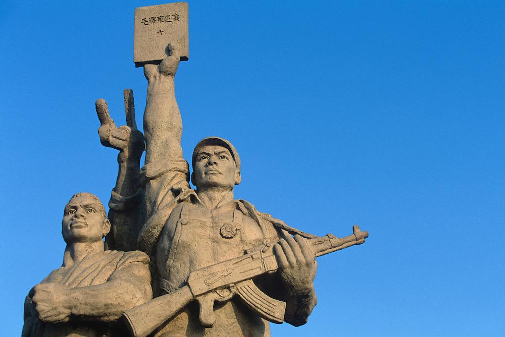 China, Jiangxi Province, Nanjing, Setting sun lights revolutionary statue on Yangtze River Bridge