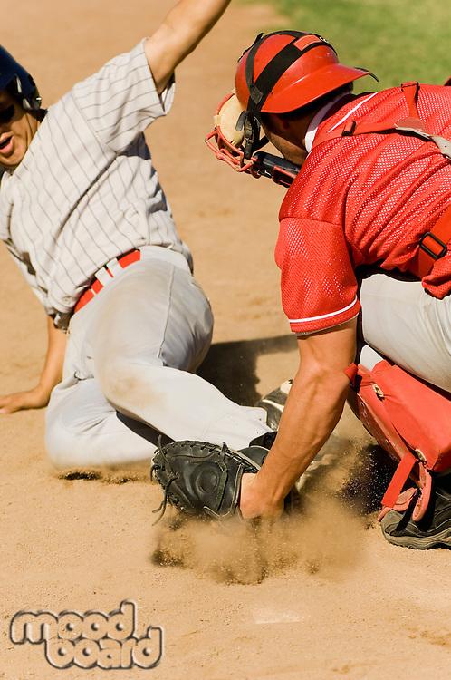 Baseball players at home base (close-up)