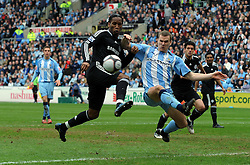 Didier Drogba of Chelsea  challenges Ben Turner of  Coventry City during the FA Cup Sponsored by E.ON 6th round match between Coventry City and Chelsea at the Ricoh Arena on March 7, 2009 in Coventry, England.