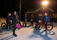 Kale Poland explains the layout of the course prior to the start of the Fatbike Fury night race at Gunstock Nordic on Saturday evening. Racers (l-r) Mike Baron, Alex Indeck, Bill Sherman, Mark Traeger, William Groat, Tucker Nugent and Hugh Ruthuen.   (Karen Bobotas/for the Laconia Daily Sun)