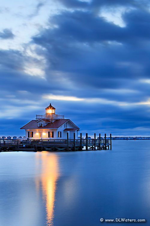 This picture of the Outer Banks Manteo lighthouse at twilight seems to be floating in a sea of blue.