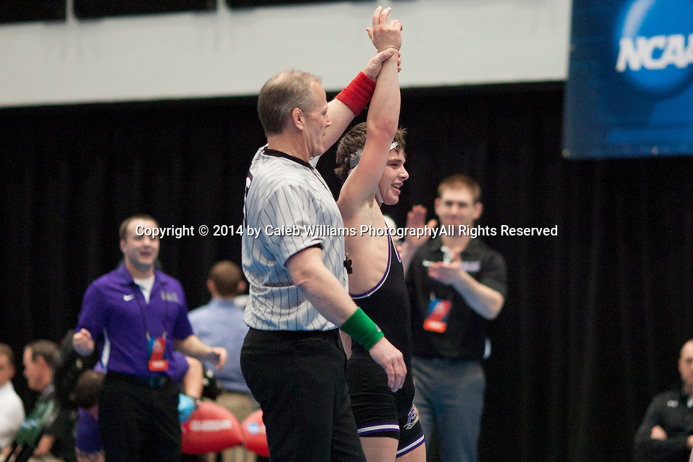 NCAA Division III Wrestling National Championships<br /> Session III<br /> <br /> CEDAR RAPIDS, Iowa (Feb. 15, 2014) -- Jeremy Border (Mount Union) has his hand raised after finishing third during Session III of the 2014 Wrestling National Championships at the US Cellular Center in Cedar Rapids, Iowa. Border defeated Ryan O`Boyle (McDaniel) 15-6.