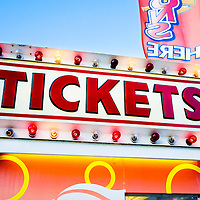 Photo of carnival tickets sign at on a ticket stand. Also commonly seen  at amusement parks, county fairs and fesitvals.