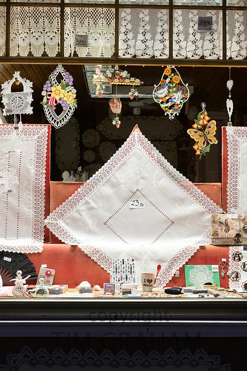Shop window of traditional lace and linen gifts and souvenirs in shop in Bruges, Belgium