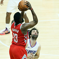 28 February 2018: Houston Rockets guard James Harden (13) takes a jump shot over LA Clippers guard Milos Teodosic (4) during the Houston Rockets 105-92 victory over the LA Clippers, at the Staples Center, Los Angeles, California, USA.