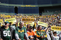 GREEN BAY, WI - OCTOBER 17: Fans of the Green Bay Packers cheer against the Miami Dolphins at Lambeau Field on October 17, 2010 in Green Bay, Wisconsin. The Dolphins defeated the Packers 23-20 in overtime. (Photo by Tom Hauck/Getty Images) *** Local Caption ***