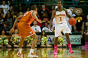 WACO, TX - JANUARY 25: Kenny Chery #1 of the Baylor Bears brings the ball up court against the Texas Longhorns on January 25, 2014 at the Ferrell Center in Waco, Texas.  (Photo by Cooper Neill/Getty Images) *** Local Caption *** Kenny Chery