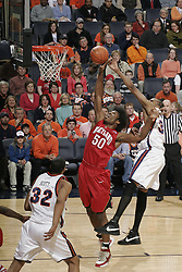 Maryland forward Bambale Osby (50) shoots past Virginia forward Adrian Joseph (30).  The Virginia Cavaliers defeated the Maryland Terrapins 91-76 at the University of Virginia's John Paul Jones Arena  in Charlottesville, VA on March 9, 2008.