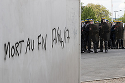 "© Licensed to London News Pictures. 16/04/2017. Paris, France. "" Death to the Front National "" sprayed on a wall . Antifascist protesters opposed to a meeting by French far-right party , Front National , hold a demonstration in the North East of Paris . Photo credit: Joel Goodman/LNP"