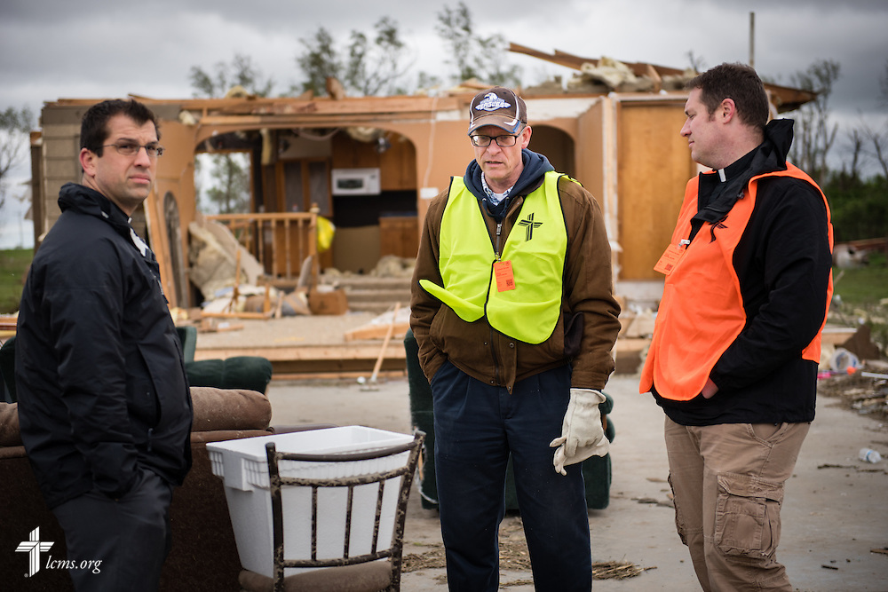 (L-R) The Rev. Ross Johnson, director of LCMS Disaster Response, newly elected South Dakota District President Rev. Scott Sailer of Sioux Falls, and the Rev. Michael Meyer, manager of LCMS Disaster Response, survey a destroyed farm on Monday, May 11, 2015, in Delmont, S.D. A tornado swept through the area the previous day and destroyed Zion Lutheran Church and nearby buildings. LCMS Communications/Erik M. Lunsford